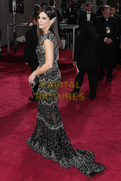 Sandra Bullock  .85th Annual Academy Awards held at the Dolby Theatre at Hollywood & Highland Center, Hollywood, California, USA..February 24th, 2013.oscars full length black dress side profile.CAP/ADM/SLP/COL.©Colin/StarlitePics/AdMedia/Capital Pictures