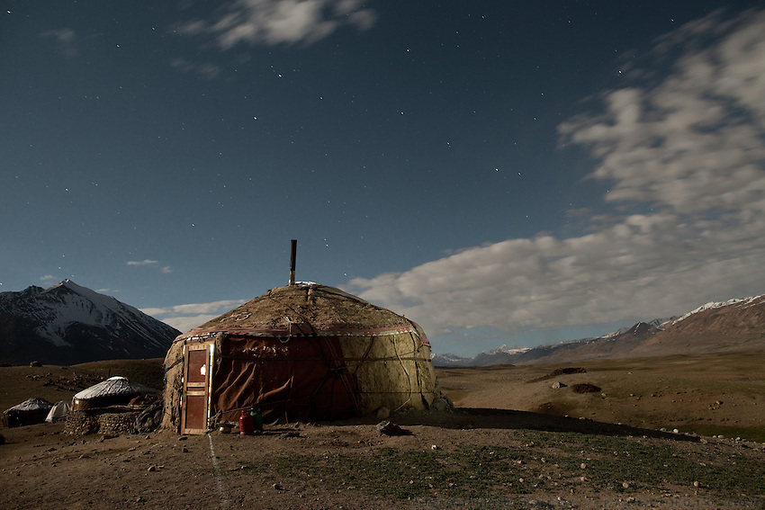 Night shot of yurt, under a full moon..Summer camp of Muqur, Er Ali Boi's place...Trekking through the high altitude plateau of the Little Pamir mountains (average 4200 meters) , where the Afghan Kyrgyz community live all year, on the borders of China, Tajikistan and Pakistan.