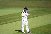 PICTURE BY VAUGHN RIDLEY/SWPIX.COM - Cricket - County Championship Div 2 - Yorkshire v Essex, Day 3 - Headingley, Leeds, England - 21/04/12 - Yorkshire's Joe Root reads a note passed to him by the 12th man during the match.