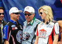 Mar. 6, 2011; Las Vegas, NV, USA; NHRA funny car drivers Robert Hight (left), John Force (center) and Courtney Force during the Kobalt Tools 400 at Las Vegas Motor Speedway. Mandatory Credit: Mark J. Rebilas-