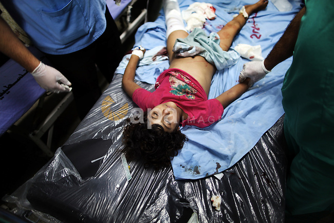 Palestinian children, wounded in an Israeli strike on a compound housing a U.N. school in Beit Hanoun, in the northern Gaza Strip, lay on the floor of an emergency room at the Kamal Adwan hospital in Beit Lahiya, Thursday, July 24, 2014. Israeli tank shells hit the compound, killing more than a dozen people and wounding dozens more who were seeking shelter from fierce clashes on the streets outside. Gaza health official Ashraf al-Kidra says the dead and injured in the school compound were among hundreds of people seeking shelter from heavy fighting in the area.. Photo by Ali Jadallah