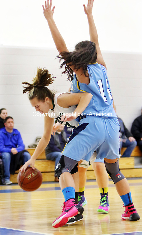 MIDDLEBURY CT. 16 January 2015-011616SV17-#24 Maddy Jensen of Chase Collegiate School takes the ball up court as she is defended  by #14 Chaylee McAdam of Westover School defends during basketball action in Middlebury Saturday. <br /> Steven Valenti Republican-American