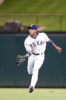Texas Rangers outfielder Endy Chavez #9 makes a running catch during the Major League Baseball game against the Texas Rangers at the Rangers Ballpark in Arlington, Texas on July 27, 2011. Minnesota defeated Texas 7-2.  (Andrew Woolley/Four Seam Images)