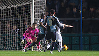 Anthony Stewart of Wycombe Wanderers goes in for the ball from Adam Campbell of Notts County resulting in a penalty during the Sky Bet League 2 match between Wycombe Wanderers and Notts County at Adams Park, High Wycombe, England on 15 December 2015. Photo by Andy Rowland.