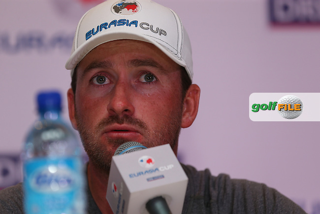 Team Europe's Graeme McDowell (NIR) first to acknowledge that he and Jamie Donaldson (WAL) did not play their best but thankful that they came away with a 2&1 win during the second day Foursome matches at the 2014 EurAsia Cup presented by DRB-Hicom, at the Glenmarie Golf & Country Club, Kuala Lumpur, Malaysia. Picture:  David Lloyd / www.golffile.ie