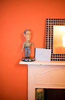 George Bush on mantel, Louis room, London, UK