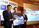 December 1, 2016, Tokyo, Japan - (L-R) Japanese travel agency H.I.S. president Hideo Sawada, Japanese space travel venture PD Aerospace president Syuji Ogawa and ANA Holdings president Shinya Katanosaka display an image of space traveler as they announce that H.I.S. and ANA will make capital and business tie-up with PD Aerospace at a press conference in Tokyo on Thursday, December 1, 2016. PD Aerospace is expecting to launch space travel service with other two companies in 2023.  (Photo by Yoshio Tsunoda/AFLO) LWX -ytd-