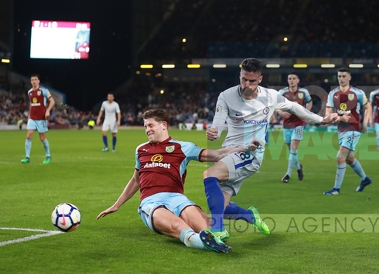 Olivier Giroud of Chelsea gets a shot past James Tarkowski of Burnley during the premier league match at the Turf Moor Stadium, Burnley. Picture date 19th April 2018. Picture credit should read: Simon Bellis/Sportimage