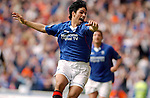 Milel Arteta celebrates scoring his penalty to seal the Championship for Rangers