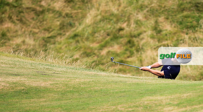 Chris Tormey (Mullingar) in the rough on the 13th during the South of Ireland Amateur Open Championship Third Round at Lahinch Golf Club  29th July 2013 <br /> Picture:  Thos Caffrey / www.golffile.ie