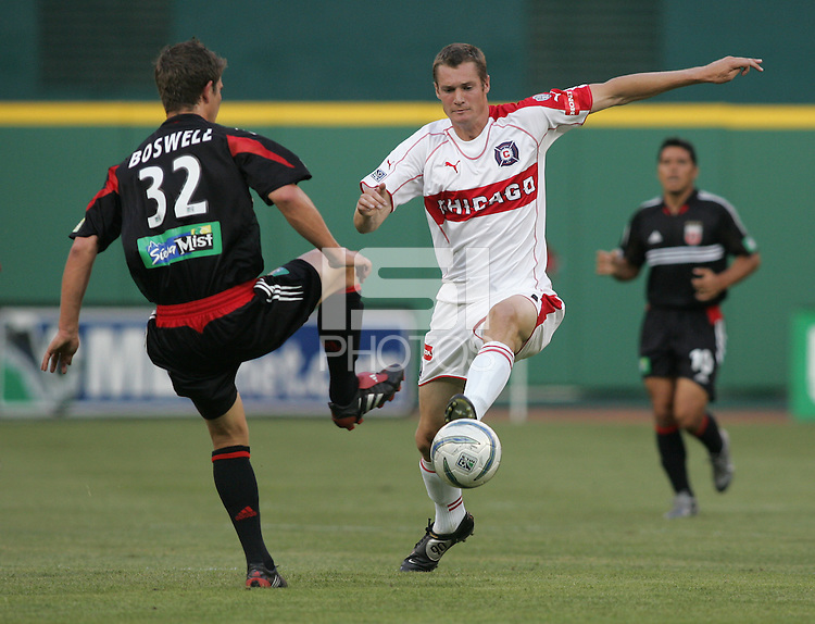 June 15, 2005; Washington, DC, USA; DC United's Bobby Boswell (23) has the ball taken away from him by the Chicago Fire's Nate Jaqua (11) at RFK Stadium. DC United  won the game, 4-3.