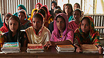 Girls in class in West Fasura, a village on an island in the Brahmaputra River in northern Bangladesh.