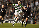 26/11/2005         Copyright Pic : James Stewart.File Name : sct_jspa18 celtic v dunfermline.JOHN HARTSON AND AARON LABONTE CHALLENGE FOR THE BALL...Payments to :.James Stewart Photo Agency 19 Carronlea Drive, Falkirk. FK2 8DN      Vat Reg No. 607 6932 25.Office     : +44 (0)1324 570906     .Mobile   : +44 (0)7721 416997.Fax         : +44 (0)1324 570906.E-mail  :  jim@jspa.co.uk.If you require further information then contact Jim Stewart on any of the numbers above.........