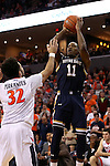 02 January 2016: Notre Dame's Demetrius Jackson (11) shoots over Virginia's London Perrantes (32). The University of Virginia Cavaliers hosted the University of Notre Dame Fighting Irish at the John Paul Jones Arena in Charlottesville, Virginia in a 2015-16 NCAA Division I Men's Basketball game. Virginia won the game 77-66.