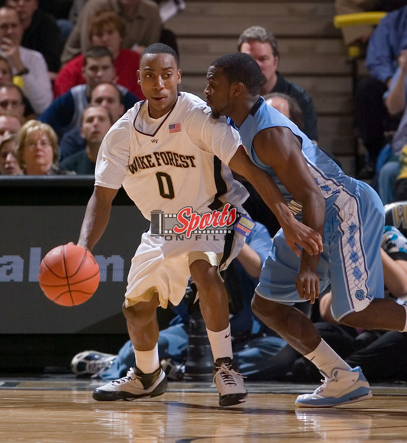 WINSTON-SALEM, NC - JANUARY 11:  Jeff Teague #0 of the Wake Forest Demon Deacons is guarded by Ty Lawson #5 of the North Carolina Tar Heels during second half action at the LJVM Coliseum January 11, 2009 in Winston-Salem, North Carolina.  The Demon Deacons defeated the Tar Heels 92-89.  (Photo by Brian Westerholt / Sports On Film)