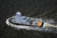 aerial photograph Kirby tugboat Maryland on Hudson River, New York, New Jersey, twin screw tug boat rated at 3,010 horsepower, buiilt in 1962 by Jakobson Shipyard of Oyster Bay, New York