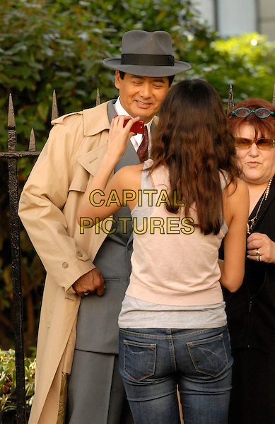 """CHOW YUN FAT .On the set of """"Shanghai"""", Waterloo, London, England..June 8th, 20008.filming movie half length beige trench coat grey gray hat.CAP/IA.©Ian Allis/Capital Pictures."""