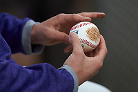 A High Point Panthers player rubs dirt on a baseball during the game against the Campbell Camels at Williard Stadium on March 16, 2019 in  Winston-Salem, North Carolina. The Camels defeated the Panthers 13-8. (Brian Westerholt/Four Seam Images)