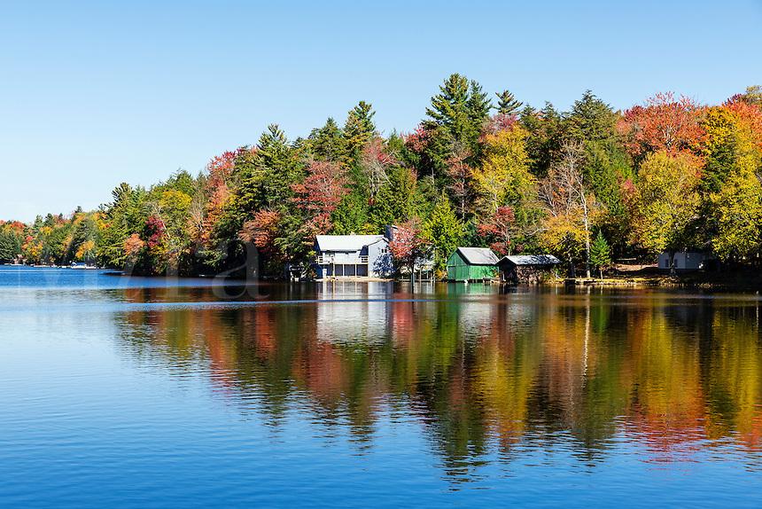 Autumn lake house on Long Lake, Woodgate, New York, USA.