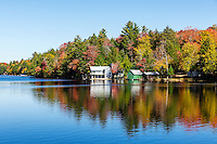 Autumn lake house on Long Lake, Woodgate, New York, USA.