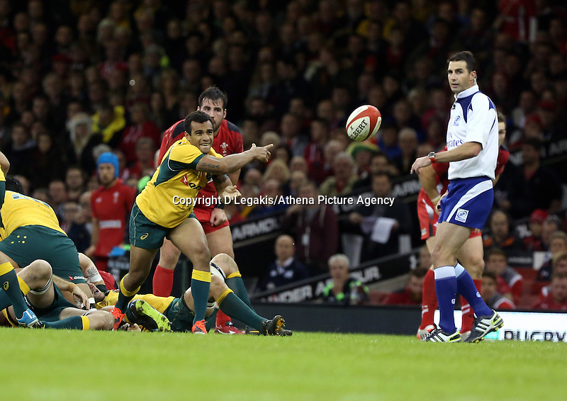 Pictured: Will Genia of Australia passing the ball. Saturday 08 November 2014<br /> Re: Dove Men Series rugby, Wales v Australia at the Millennium Stadium, Cardiff, south Wales, UK.
