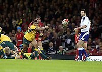 Pictured: Will Genia of Australia passing the ball. Saturday 08 November 2014<br />