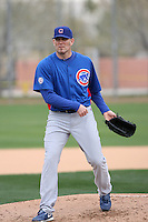 Braden Looper #41 of the Chicago Cubs participates in pitchers fielding practice during spring training workouts at the Cubs complex on February 19, 2011  in Mesa, Arizona. .Photo by Bill Mitchell / Four Seam Images.