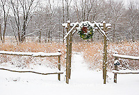 63821-174.08 Rustic fence & arbor with holiday wreath near prairie in winter, Marion Co. IL
