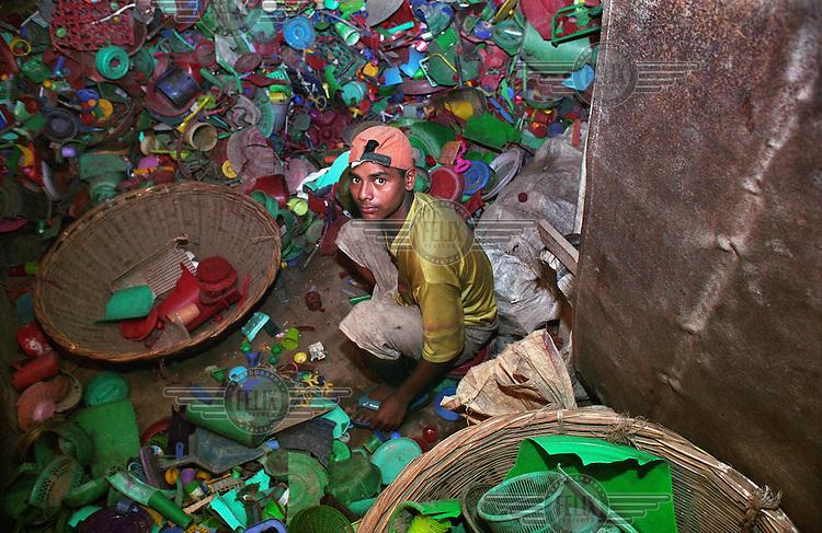 Boy recycling plastic.