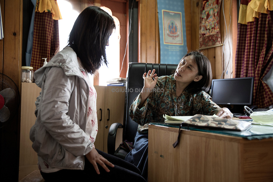 Dr. of Traditional Medicine Dorji sees a patient