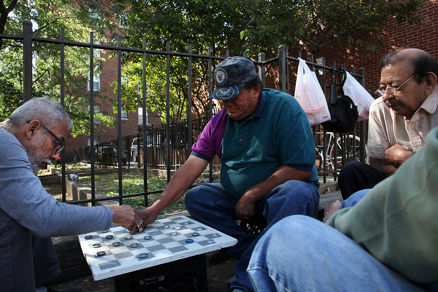 (170929RREI2808) La Esquina. The Latinos at the corner of Mt. Pleasant St. and Kenyon St. NW. Walter Martinez (l)is the unofficial mayor of the group. El Nino (c) Washington DC September 29 ,2017 . ©  Rick Reinhard  2017     email   rick@rickreinhard.com