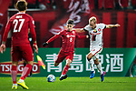 Shanghai FC Forward Oscar Emboaba Junior (L) fights for the ball with Sydney Wanderers Midfielder Mitch Nichols (R) during the AFC Champions League 2017 Group F match between Shanghai SIPG FC (CHN) vs Western Sydney Wanderers (AUS) at the Shanghai Stadium on 28 February 2017 in Shanghai, China. Photo by Marcio Rodrigo Machado / Power Sport Images