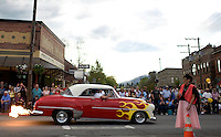 A 1952 Chevy Styline Deluxe strolls flames-a-blazin' down First Avenue in Sandpoint, ID early in the evening on Friday, May 14. The small northern Idaho town has ushered in the summer season with a 'Lost in the Fifties' weekend every year since 1986.    .. (©Matt Mills McKnight/2010)