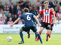Lincoln City's Callum Connolly vies for possession with Bristol Rovers' Edward Upson and Abu Ogogo<br /> <br /> Photographer Rich Linley/CameraSport<br /> <br /> The EFL Sky Bet League One - Lincoln City v Bristol Rovers - Saturday September 14th 2019 - Sincil Bank - Lincoln<br /> <br /> World Copyright © 2019 CameraSport. All rights reserved. 43 Linden Ave. Countesthorpe. Leicester. England. LE8 5PG - Tel: +44 (0) 116 277 4147 - admin@camerasport.com - www.camerasport.com