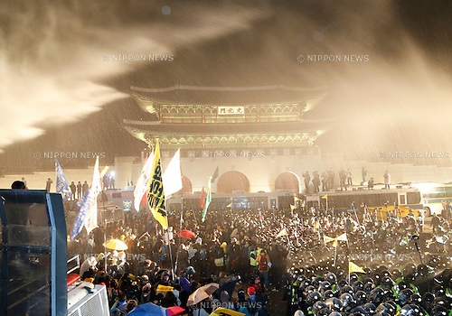 Ferry tragedy protest, Apr 18, 2015 : Policemen use a water cannon to block protesters trying to march toward Gwanghwamun gate near the presidential Blue House in Seoul, South Korea. About 30,000 people  (8,000 by police estimate) demonstrated on April 18,  two days after the first anniversary of Sewol ferry tragedy to demand that the government scrap the special Sewol Law enforcement decree, salvage the ferry and hold a thorough investigation into the tragedy. They also called for resignation of President Park Geun-hye.The police detained about 100 protesters during the protest. (Photo by Lee Jae-Won/AFLO) (SOUTH KOREA)