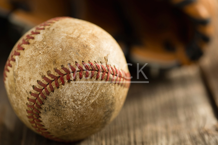 Dirty baseball on wood