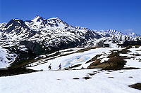 Hikers cross melting snow on the Lost Lake Trail north of Seward, Alaska, in early June. The route winds through the Kenai Mountains in Chugach National Forest. Spring comes late in higher elevations, giving fans of winter an opportunity to enjoy two seasons at once.