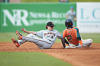 Delmarva Shorebirds shortstop Cadyn Grenier (3) reaches back to try and tag Sam Castro (2) of the Greensboro Grasshoppers as he steals second base at First National Bank Field on August 26, 2018 in Greensboro, North Carolina. The Shorebirds defeated the Grasshoppers 6-4. (Brian Westerholt/Four Seam Images)