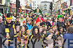 Dr Crokes footballers march through KIllarney on Monday