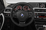 Car pictures of steering wheel view of a 2017 BMW 3-Series 320i 4 Door Sedan Steering Wheel