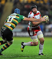 Ben Morgan of Gloucester Rugby is tackled by Michael Paterson of Northampton Saints. Aviva Premiership match, between Northampton Saints and Gloucester Rugby on November 27, 2015 at Franklin's Gardens in Northampton, England. Photo by: Patrick Khachfe / JMP