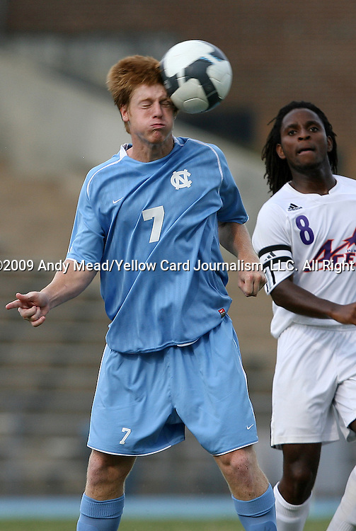 06 September 2009: UNC's Dustin McCarty (7) heads the ball. The University of North Carolina Tar Heels defeated the Evansville University Purple Aces 4-0 at Fetzer Field in Chapel Hill, North Carolina in an NCAA Division I Men's college soccer game.