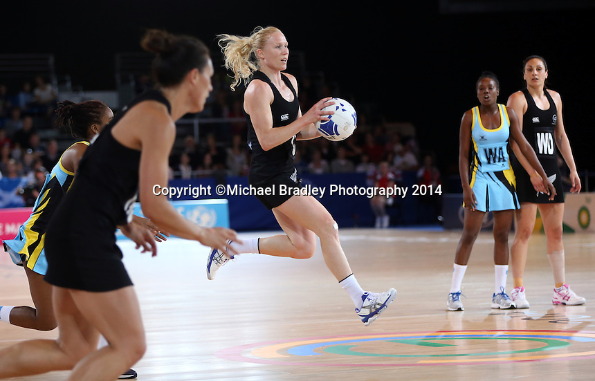 29.07.2014 Silver Ferns Laura Langman in action during the New Zealand Silver Ferns v Saint Lucia netball match at the Commonwealth Games Glasgow Scotland on the 29th of July 2014. Mandatory Photo Credit ©Michael Bradley.