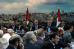 Senior Hamas leader Ismail Haniyeh speaks during the visit of Palestinian Prime Minister Rami Hamdallah, at Haniyeh's house in Gaza city on October 9, 2014. The Palestinian unity government which took the oath of office in June under technocrat prime minister Rami Hamdallah arrived to Gaza Strip on Thursday to convene the first fully meeting. Hamdallah said that the unity government will rebuild the bombed-out Gaza Strip following a seven-week Israeli offensive. Photo by Abed Rahim Khatib