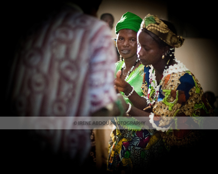 """In the town of Djibo in northern Burkina Faso, young """"doohoobe"""" (people who sing """"doohaali"""") dance in traditional fashion. The men and women each form a line facing each other, rhythmically shuffling towards and then away from each other. The women clap their hands and sing as the men """"dooho,"""" or sing a distinct, deep rhythmic chant. The men hold """"cabbi,"""" sticks which are used when herding cattle. """"Doohaali"""" is a distinct form of music practiced only by the Fulani in Djelgooji, a particular area of Burkina Faso."""