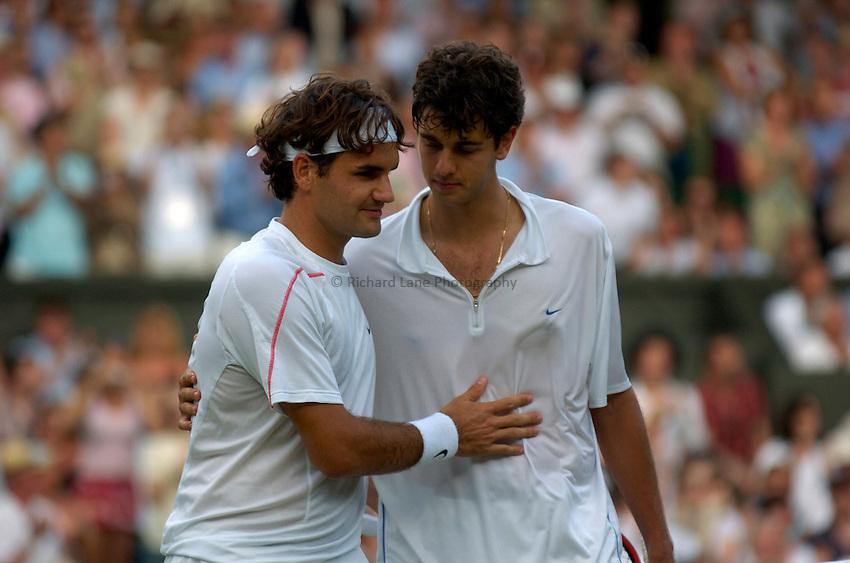 Photo: Richard Lane..Wimbledon Championships. 05/07/2006. .Roger Federer of Switzerland(lt) is congratulated by Mario Ancic of Croatia.