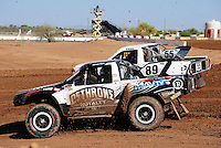 Apr 16, 2011; Surprise, AZ USA; LOORRS driver Jason Ellis (89) races alongside Matt Cook (55) during round 3 at Speedworld Off Road Park. Mandatory Credit: Mark J. Rebilas-.