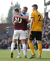 Burnley's Ashley Barnes (left) and Charlie Taylor celebrate at the final whistle<br /> <br /> Photographer Rich Linley/CameraSport<br /> <br /> The Premier League - Burnley v Wolverhampton Wanderers - Saturday 30th March 2019 - Turf Moor - Burnley<br /> <br /> World Copyright © 2019 CameraSport. All rights reserved. 43 Linden Ave. Countesthorpe. Leicester. England. LE8 5PG - Tel: +44 (0) 116 277 4147 - admin@camerasport.com - www.camerasport.com