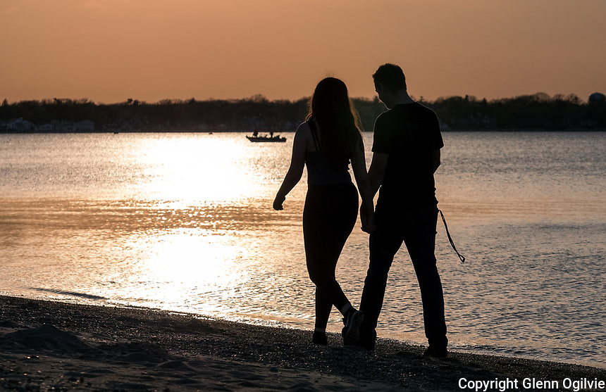 Just like clock work, spring's balmy weather brings out the romantic side of the young. Samantha DaSilva and Janesen Dawe, both Sarnia students stroll along the Canatara Park beach.