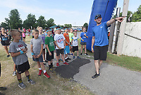 """NWA Democrat-Gazette/FLIP PUTTHOFF <br /> OBSTACLE RUNAROUND<br /> Stephen Paul with the Jones Center for Families in Springdale shows kids the route Saturday of the one-mile Obstacle Runaround over the west lawn at the center. Youngsters age 5-12 took part in the run with 15 obstacles on the course including a slip and slide, belly crawl, and water balloon toss. """"It's our version of a mud run for kids,"""" Paul said."""